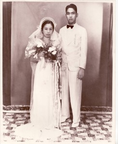 Cora's parents had five children. They survived the horrors of World War II, poverty, hardships, and at age 50, decide to move to the US to start another life. Her Inay told her that their  wedding finery could only be rented for 3 hours, so they had to hurry, get married and have the photo taken. Circa 1936.